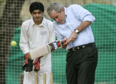President Bush playing cricket